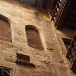 Former doorways and wooden balconies.